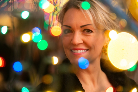 Close-up of a woman's face with multicolored lights